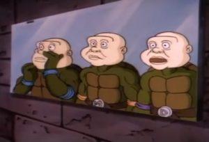 Teenage Mutant Ninja Turtles cartoon wear human masks.