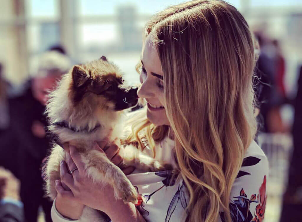 Woman with dog at Michigan Humane's Purrfect Bow Wow Brunch.