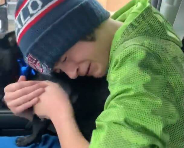 Boy reunites with his pug dog.